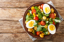 Breakfast Of Boiled Eggs And Salad Of Lupine Beans, Tomatoes And Common Cornsalad Close-up In A Plate On The Table. Horizontal Top View From Above