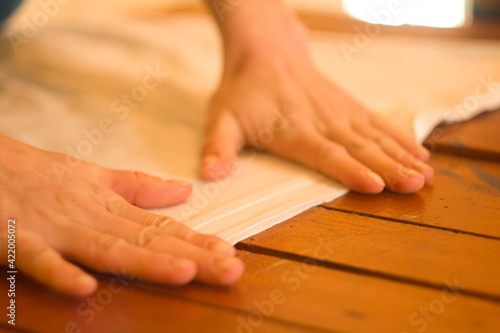 Fototapeta Close-up Of Hands On Table obraz na płótnie