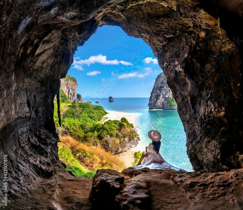 Tablou Canvas Woman sitting in the cave at Railay, Krabi, Thailand.