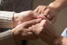 Crop Close Up Of Loving Elderly Mother Hold Hands Of Adult Daughter Show Support And Care. Supportive Mature Mom Parent Comfort Caress Millennial Grownup Child. Family Unity, Bonding Concept.