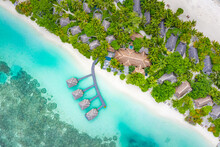 Luxury Overwater Villas With Coconut Palm Trees, Blue Lagoon, White Sandy Beach At Maldives Islands. Top View, Summer Vacation, Holiday Landscape. Amazing Relaxing Nature Aerial Scene, Traveling Scene
