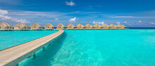 Ocean Lagoon Bay View, Blue Sky And Clouds With Wooden Jetty And Over Water Bungalows, Villas, Endless Horizon. Meditation Relaxation Tropical Background, Sea Ocean Water. Skyscape Seascape Background