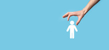 Male Hand Holding Human Icon On Blue Background. Human Resources HR Management Recruitment Employment Headhunting Concept.Select Team Leader Concept. Male Hand Click On Man Icon.Banner ,copy Spase.