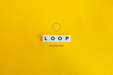 Loop Or Circular Economy Banner And Concept. Block Letters On Bright Orange Background. Minimal Aesthetics.