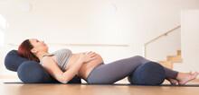 Pregnant Woman Is Engaged In Yoga. Reclined Goddess Pose Or Supta Baddha Konasana