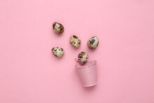 Easter Composition. Mini Bucket And Quail Eggs On A Pink Pastel Background. Top View