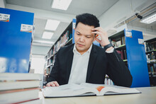 Young Entrepreneur Working In Library For Reading Literature Review Of Research. Concept For Academic And Education In University.