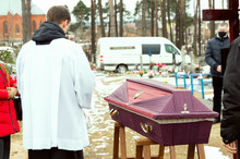 Funeral Ceremony. A Closed Coffin Stands In The Cemetery