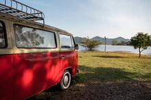 Vintage Camper Van Parked In Campsite On Lakeside