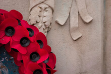 Red Poppy Wreaths Laid At The Bottom Of A War Memorial For Remembrance Day