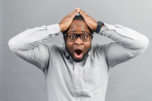 Portrait Of Forgetful Young African American Customer Or Employee Wearing Shirt Looking With Shocked And Guilty Expression, Holding Hands On His Head, Opening Mouth Widely, Body Language, Oh No