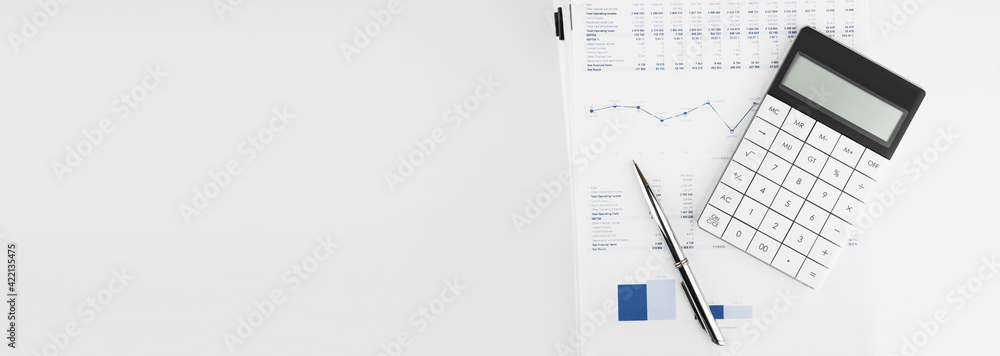Fototapeta Calculator, Charts and Graphs spreadsheet paper. Finance, Accounting, Statistics and business concept.