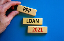 PPP, Paycheck Protection Program Loan 2021 Symbol. Concept Words PPP Loan 2021 On Blocks On A Beautiful Blue Background. Business, PPP - Paycheck Protection Program Loan 2021 Concept.