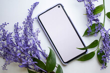 Phone Mockup With Violet Flowers