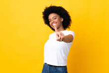 Young African American Woman Isolated On Yellow Background Showing And Lifting A Finger