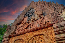 Banteay Srei - Cambodian Temple Dedicated To The Hindu God Shiva. Ancient Khmer Ruins In The Jungle. Red Sandstone Monument. Bas-relief Depicting Battle