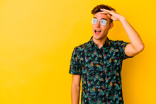 Young Caucasian Man Wearing A Hawaiian Shirt Isolated On Yellow Background Looking Far Away Keeping Hand On Forehead.