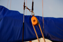 Pulley And Rope On A Restored Antique Sailboat At Sunrise On The New England Coast