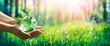 Leinwandbild Motiv Environment Concept - Hands Holding Globe Glass In Green Meadow With Sunlight