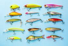 Fishing Spinning Colorful Wobblers Or Lures On Blue Background. Fishing Background