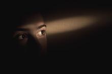 Single Ray Of Light Falling Over Girls Eyes