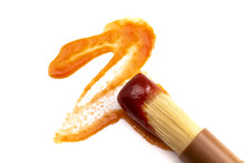 Wooden Culinary Brush Dipped In Barbecue Sauce On A White Background