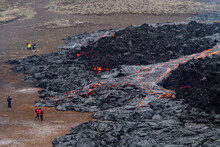 GELDINGADALIR, ICELAND - MARCH 21, 2021: A Small Volcanic Eruption Started At The Reykjanes Peninsula. The Event Has Attracted Thousands Of Visitors Who Have Braved A Daring Hike To The Crater.