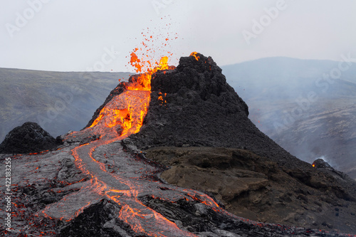 Fototapeta GELDINGADALIR, ICELAND - MARCH 21, 2021: A small volcanic eruption started at the Reykjanes peninsula