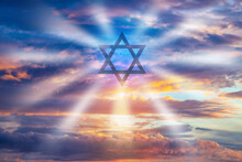 Judaism Logo On Sky Background. Star Of David As A Symbol Of Jewish Religion. Symbol Of Judaism Religion. Jewish Religion. Concept - Visits To Jewish Senagogue. Star Of David Emits Rays Of Light.