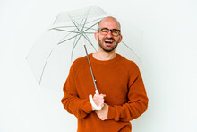 Young Bald Man Holding An Umbrella Isolated Laughing And Having Fun.