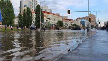 Flooded City Streets After Heavy Rain People In Water