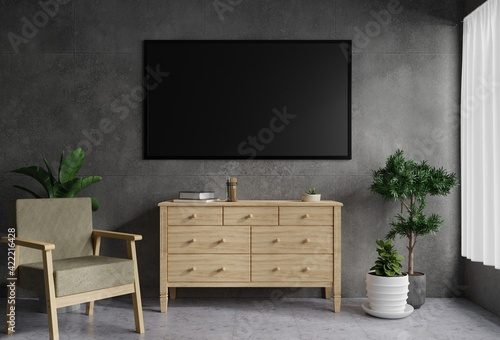 Fototapeta TV on the concrete wall in the living room is decorated with a wooden table. There was a plant pot on the side and an armchair on the tile floor.3d rendering. obraz