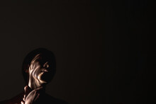 Human Trafficking. Female Slavery. Forced Labour. Art Portrait Of Suffering Hostage Woman Silhouette With Hands On Throat Abstract Shadow On Face Isolated On Black Night Empty Space Background.
