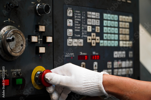 Press the emergency button on cnc machine control panel at factory