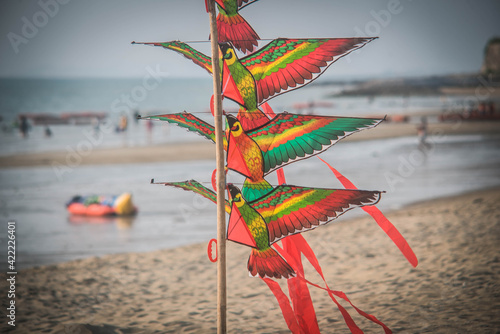 Kites are available for sale on the beachside, Pattaya, Thailand Fototapet