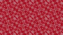 万華鏡のように変化する赤とピンクの市松模様の背景