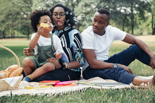 Happy Picnic Relax Black People Family With Son Blowing Bubbles In Garden