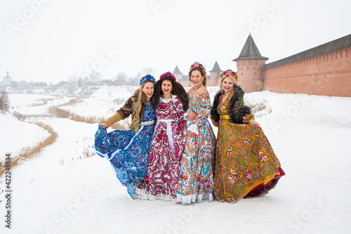 Fotografie, Tablou Russian girl in Russian national costumesof winter in a village