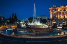 Naiads Fountain With Bronze Statues By Mario Rutelli In Piazza Della Repubblica In Rome At Night, Italy.