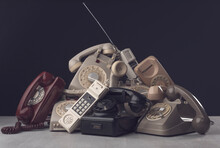 Heap Of Vintage Telephones And Receivers
