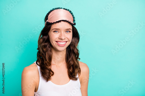 Portrait of charming curly hairstyle person beaming smile look camera isolated on turquoise color background