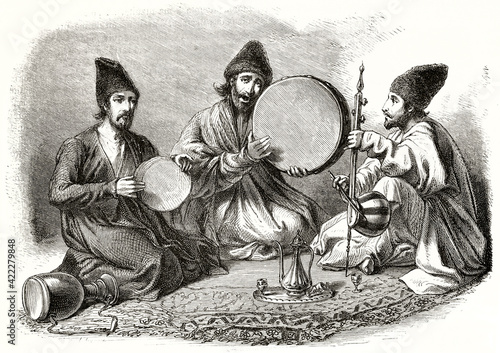 Obraz na plátně Persian musicians playing traditional percussion instruments crouched on a oriental carpet