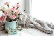 Festive Flower Arrangement For Mother's Day With Fresh Flowers And Knitted Element Copy Space.