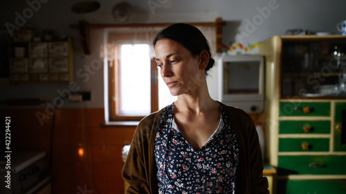 Obraz Portrait of poor mature woman indoors at home, poverty concept. - fototapety do salonu