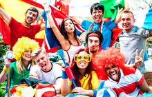 Young Football Supporter Fans Cheering With International Flags At Soccer Match - Happy People With Multicolored Tshirts Having Fun Together Outdoors - Sport Championship Concept On Warm Vivid Filter