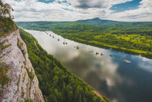 Aerial View Of Blue River And Forest In A Classic Moutain Valley. Scenic Russian Forest And River Flow In Moutain. River Flowing Among Moutain Ridges.
