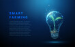 Abstract blue glowing light bulb with green plant inside