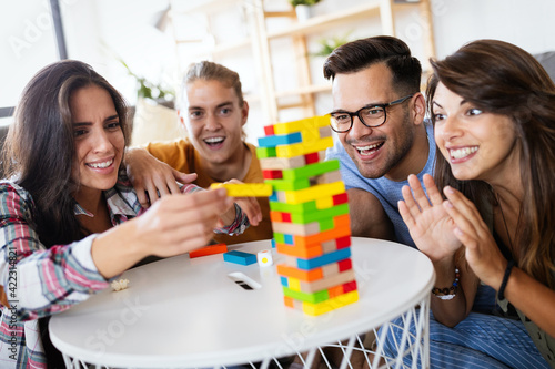 Happy group of friends have fun and playing board game together Fotobehang