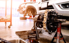 Closeup Detail Of Car Engine In Service Center With Soft-focus And Over Light In The Background