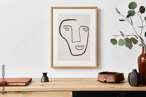 Tela Stylish interior of living room with mock up poster frame, wooden commode, book, eucalyptus leaf in ceramic vase and elegant personal accessories